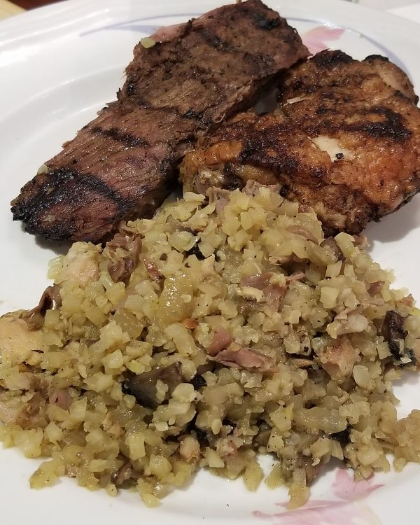 ketogenic meal of flank steak, chicken thighs, and bacon and mushroom cauli rice